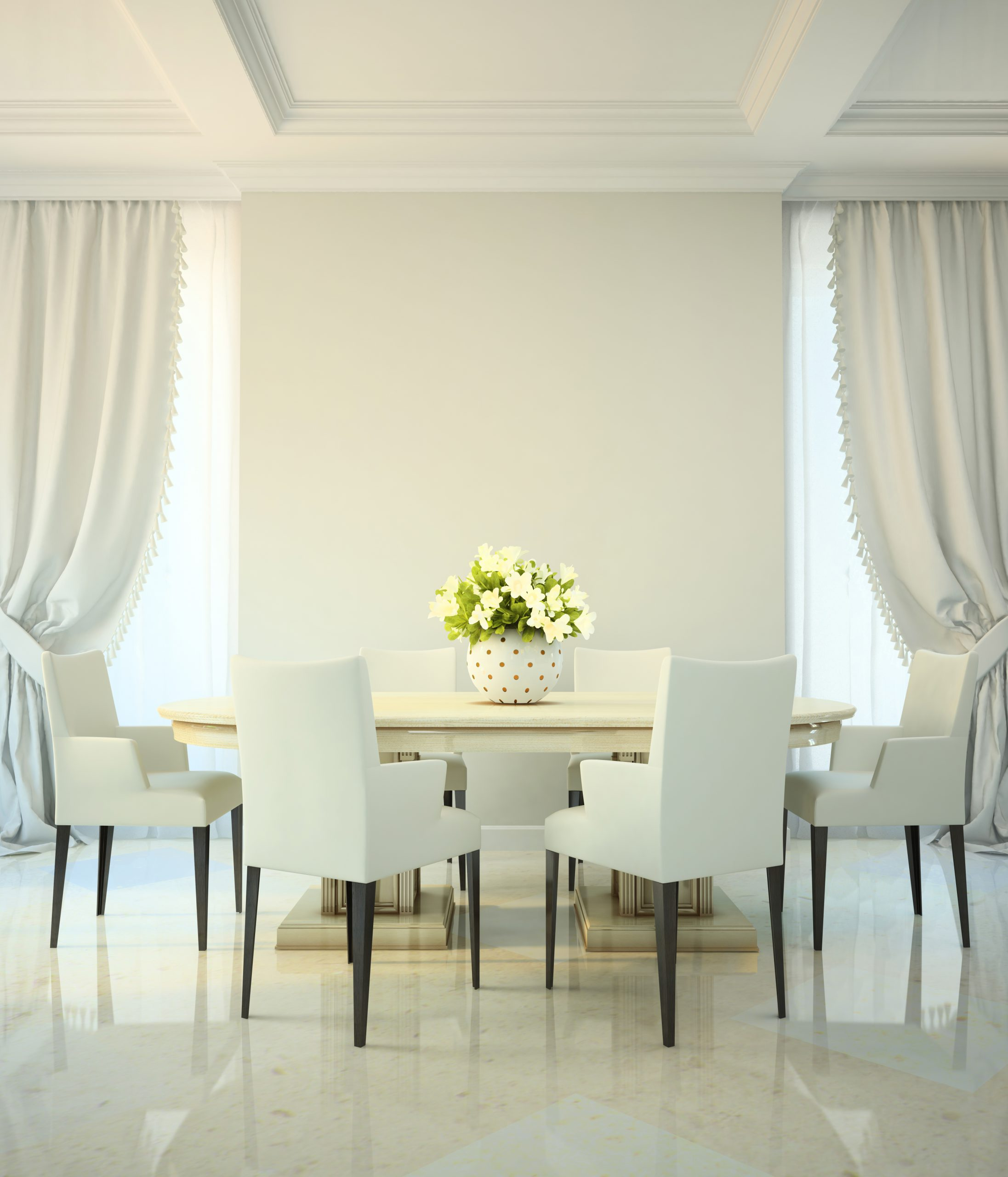 Six white chairs and a table